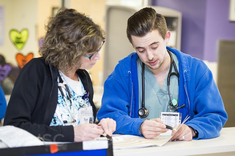 Staff in our inpatient pediatric unit review a patient's PEWS score