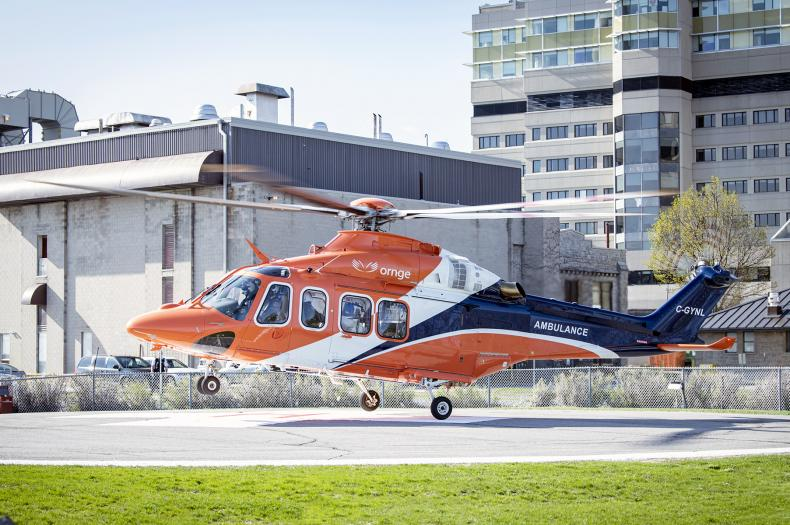 An Ornge air ambulance lands at the KGH site