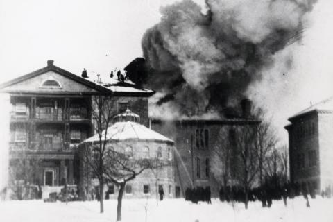 Fire engulfs the Watkins Wing in 1897. Firemen and volunteers managed to save the main building by passing buckets of water.