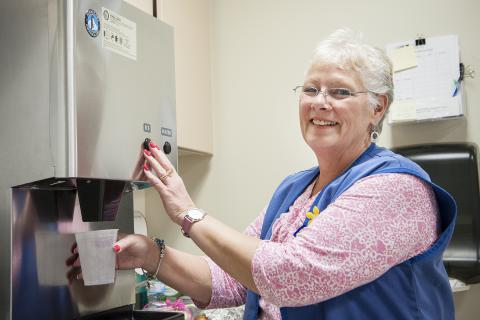 Volunteer Judy Torrents regularly delivers ice water to chemotherapy patients.