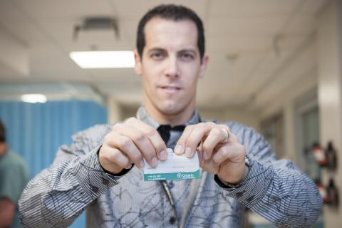 Emergency Department physician Dr. Ian Ball rips up an old donor card as part of The Gift of 8 Movement which is encouraging people at KGH to register online as potential donors.
