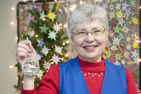 Merna Manders, co-convenor of the Auxiliary's Patient Comforts Committee, shows off the ornament that will be given out to patients this Christmas Eve.