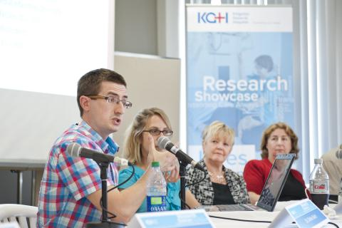 Researchs present their findings to a crowd at KGH.