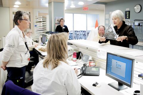 Patient Experience Advisors Anndale McTavish and Glenn Outhwaite will be part of this week's celebration. They are seen here taking our NRC Picker Innovative Best Practice Award 2012 on a tour of the hospital to share it with front-line staff.
