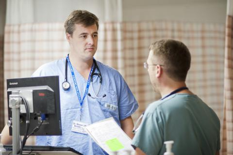 Dr. Steven Brooks talking to a colleague in the Emergency Department at KGH.