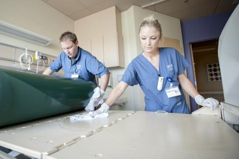 (From left) Environmental Assistants Ronnie Lott and Zabrina Ferguson work to ensure each patient room is cleaned to the highest standard.