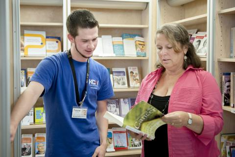 Volunteer Tanner Hoffman and Patient Experience Advisor Angela Morin looks over some of the materials now available in the new resource centre located in the Burr Wing lobby.