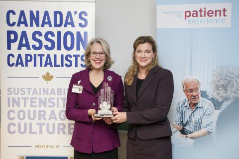KGH President & CEO Leslee Thompson receives KGH's Passion Capital Award from Leslie Carter, Chief Brand & Strategy Officer at Knightsbridge Human Capital Solutions on December 1, 2014.