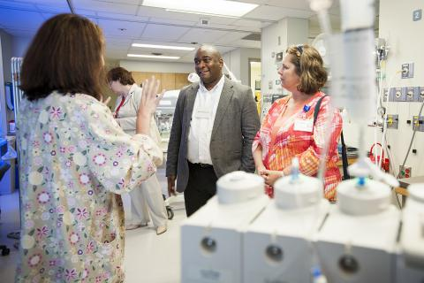 Bernard Roberson from Georgia Regents Health and Angela Morin, KGH Patient Experience Advisor, talk with staff in our newly renovated Neonatal Intensive Care Unit about the new Family Integrated Care model they are helping pioneer.