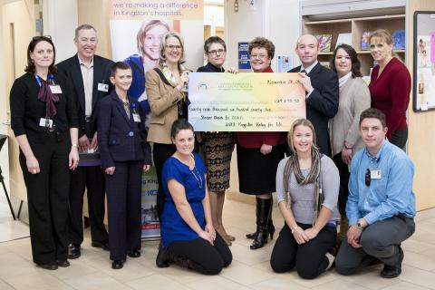 KGH staff standing for group photo around large cheque of $29,672.32 for Relay for Life
