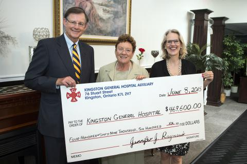 Auxiliary President Jenny Raymond hands a cheque worth just under $470,000 to KGH Board Chair Scott Carson and CEO Leslee Thompson.