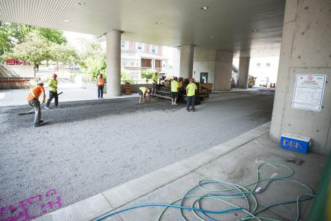 Construction crews prepare to lay asphalt under the front canopy.