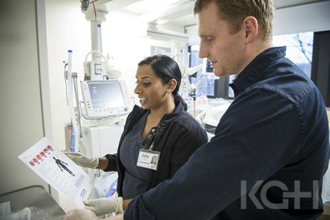 RN Julia John is one of KGH's new skin and wound care nurse champions. Here she shares pressure ulcer prevention strategies with Nursing Student Scott Conway in the Kidd 2 ICU.