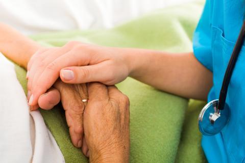 Nurse and elderly hands