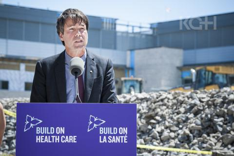 Minister of Health and Long-Term Care Dr. Eric Hoskins addresses guests and the media during the announcement.