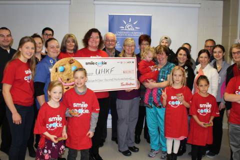 Representatives from local Tim Hortons present the proceeds of the campaign to KHSC and UHKF staff, patients and families