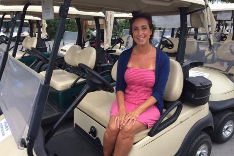 Breast cancer survivor Liz Adamson spoke to the golfers about her experience and how their support impacted her life