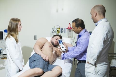 Amer Johri sees a patient