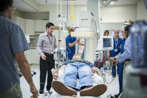 KHSC staff and physicians in an Interventional Radiology suite during an EVT simulation case