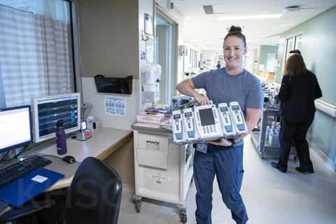 Kadie Weekes, a Critical Care Nurse on Davies 4 ICU receives a new Alairs Infusion controller with pump modules during the implementation phase of the project.