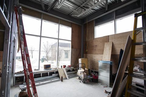 The new patient waiting area for the second MRI is a bright and open space overlooking Lake Ontario