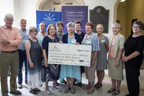 Members of the KGH Auxiliary present a cheque to representatives of the University Hospital's Kingston Foundation as well as the KHSC Board of Directors and Executive team.