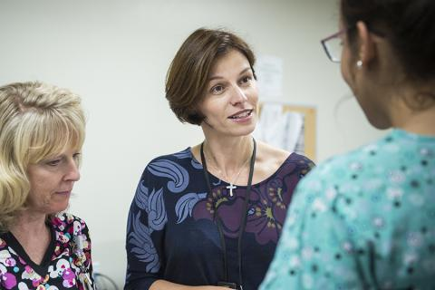 Dr. Glykeria Martou, a physician with with Kingston Health Sciences Centre speaks with a patient about her breast cancer treatment options