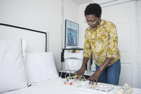 Thanks to her home dialysis machine, Patient Experience Advisor Karen Nicole Smith is able do her treatment in the comfort of her own home, rather than in a hospital setting.