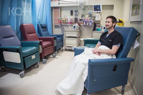 Drew Henson, Registered Nurse, demonstrating how the new lounge chairs work in the ED.