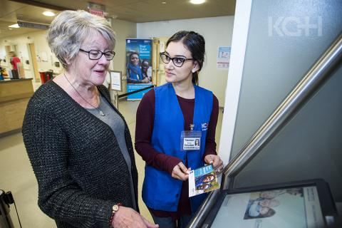 A patient in the Cancer Care centre at KGH learns about the new kiosks.