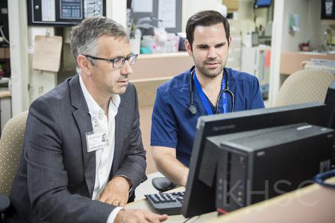 Dr. Damon Dagnone and resident Dr. Aaron Ruberto take a look at the new online system that will be used to provide feedback to residents