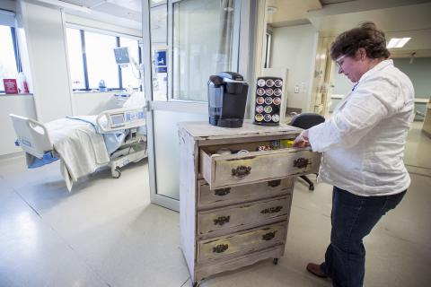 A member of the ICU team checks the supplies in the compassionate care cart