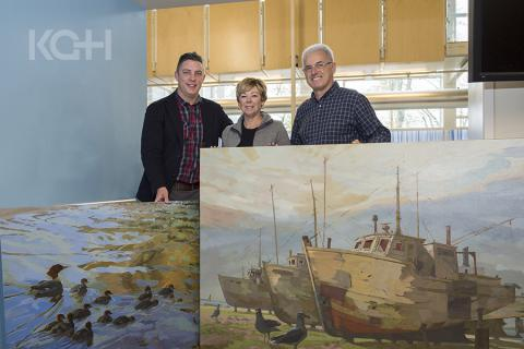 (Left) Tyler Hands, Program Manager of Inpatient and Ambulatory Oncology, thanks artist Robert Shackles and his wife Sylvia for their two big donations to our art collection.