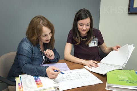 Angela Hollett, left, and her colleague Brittany examine plans for a future milk-prep room at KHSC.