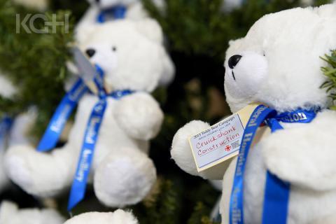 Teddy bears hang on the Christmas Tree in the Watkins Lobby