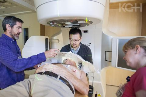 Members of the Radiation Therapy team make adjustments to the cancer centre's new Linear Accelerator for patient Lance Sheppard