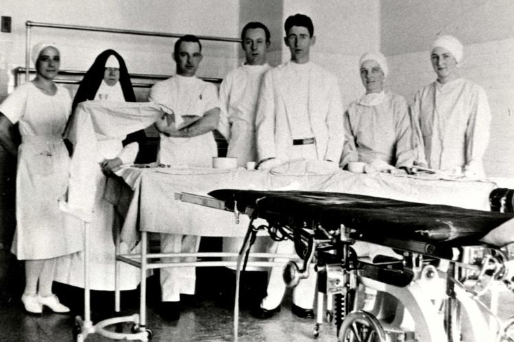 Operating Room Sister, nurses and surgeons, 1931