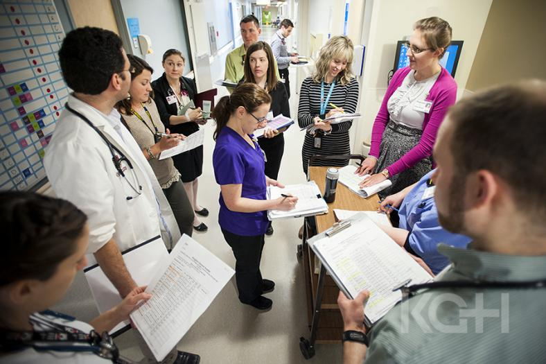 Interdisiplinary team members get together to round beofre visiting patients on their unit.