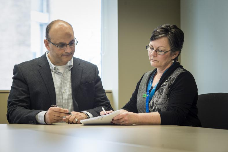 Nephrologist Dr. Khaled Shamseddin was integral in helping to develop the new program. Here he meets with Donor Coordinator Arlene Funnel to review a patient chart.