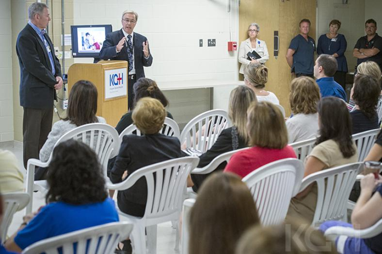 David Pichor speaks to a group of staff at a townhall meeting