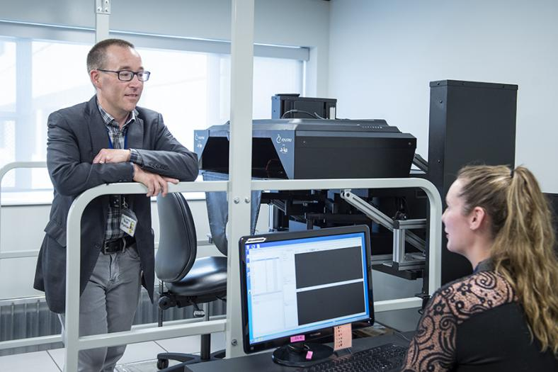 Dr. Gord Boyd and PhD candidate Jessica Vanderlinden with the KINARM in the W.J. Henderson Centre for Patient Oriented Research